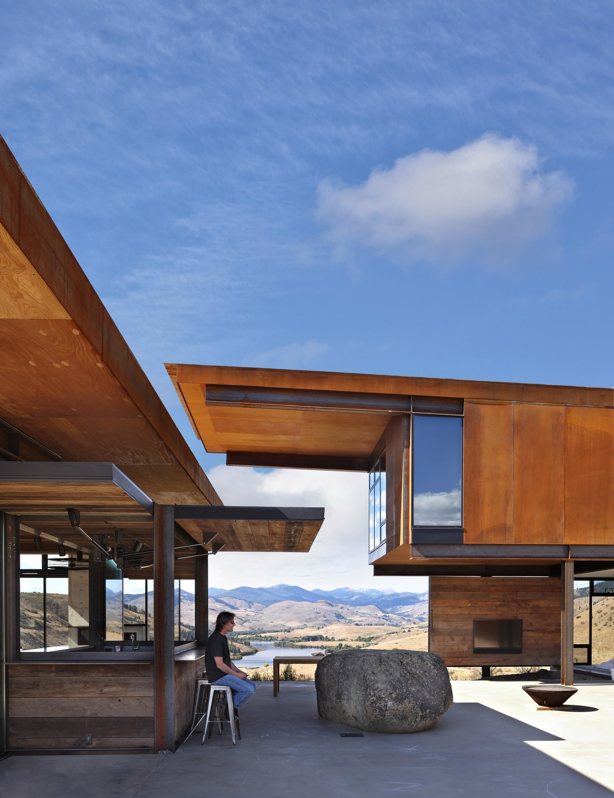 Exterior, Cabin Building Type, Metal Roof Material, Shed RoofLine, and Metal Siding Material The walls of the bar open up, giving it a playful  Photo 6 of 11 in A Steel-and-Glass Compound Is One Family's Launchpad For Adventure