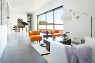 A 21-foot sliding glass pocket door opens up the living room to the outdoors, and the southern-facing opening captures winter sun. Throughout the home, windows and doors surpass Energy Star standards. The walls are made from 40% recycled material, and finished in non-VOC paint.