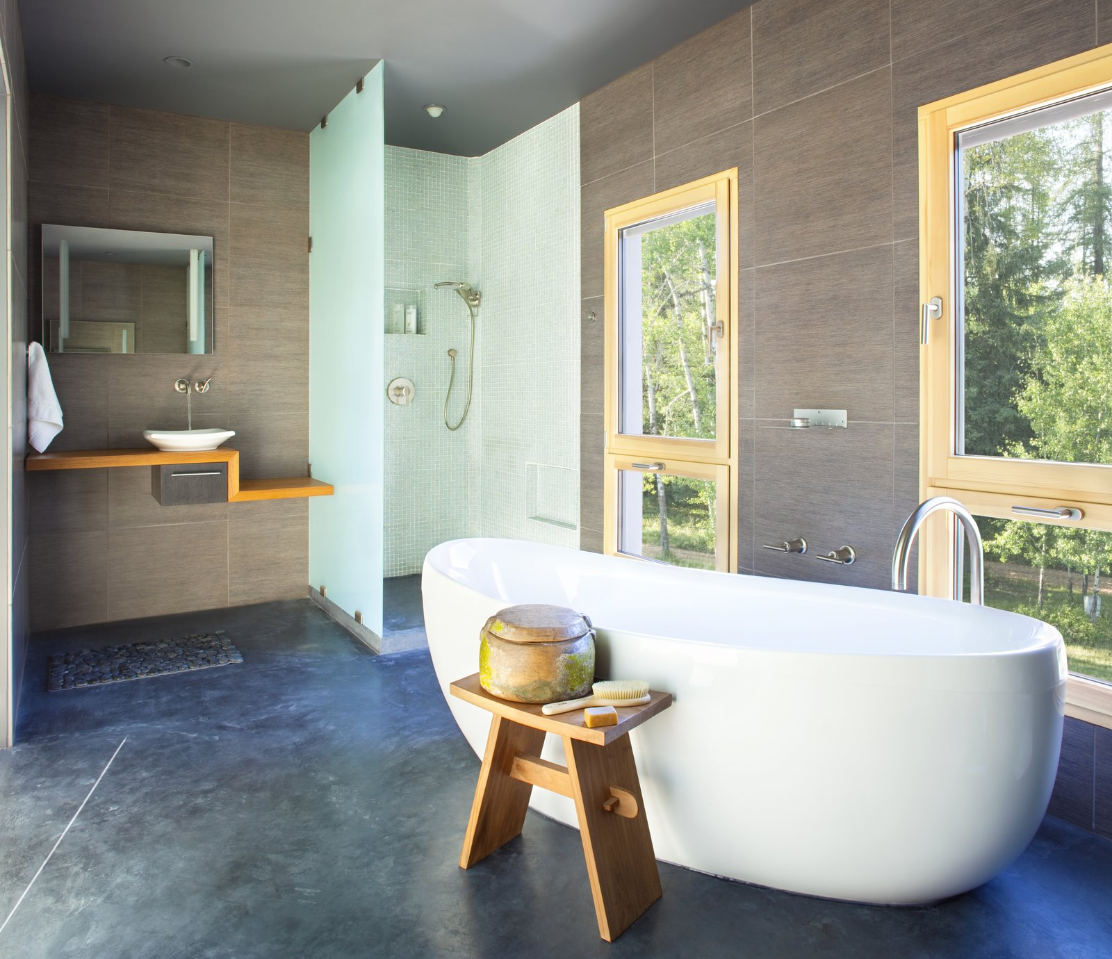 Bath Room, Concrete Floor, Vessel Sink, Freestanding Tub, Soaking Tub, and Open Shower A deep soaking tub offers relaxation and views of the surrounding foliage.  Photo 8 of 11 in A Rock & Roll Hall of Famer's Picturesque Montana Retreat Is Going Up For Auction