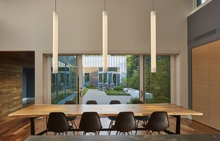Large sliding doors allow the dining area to flow into the courtyard.