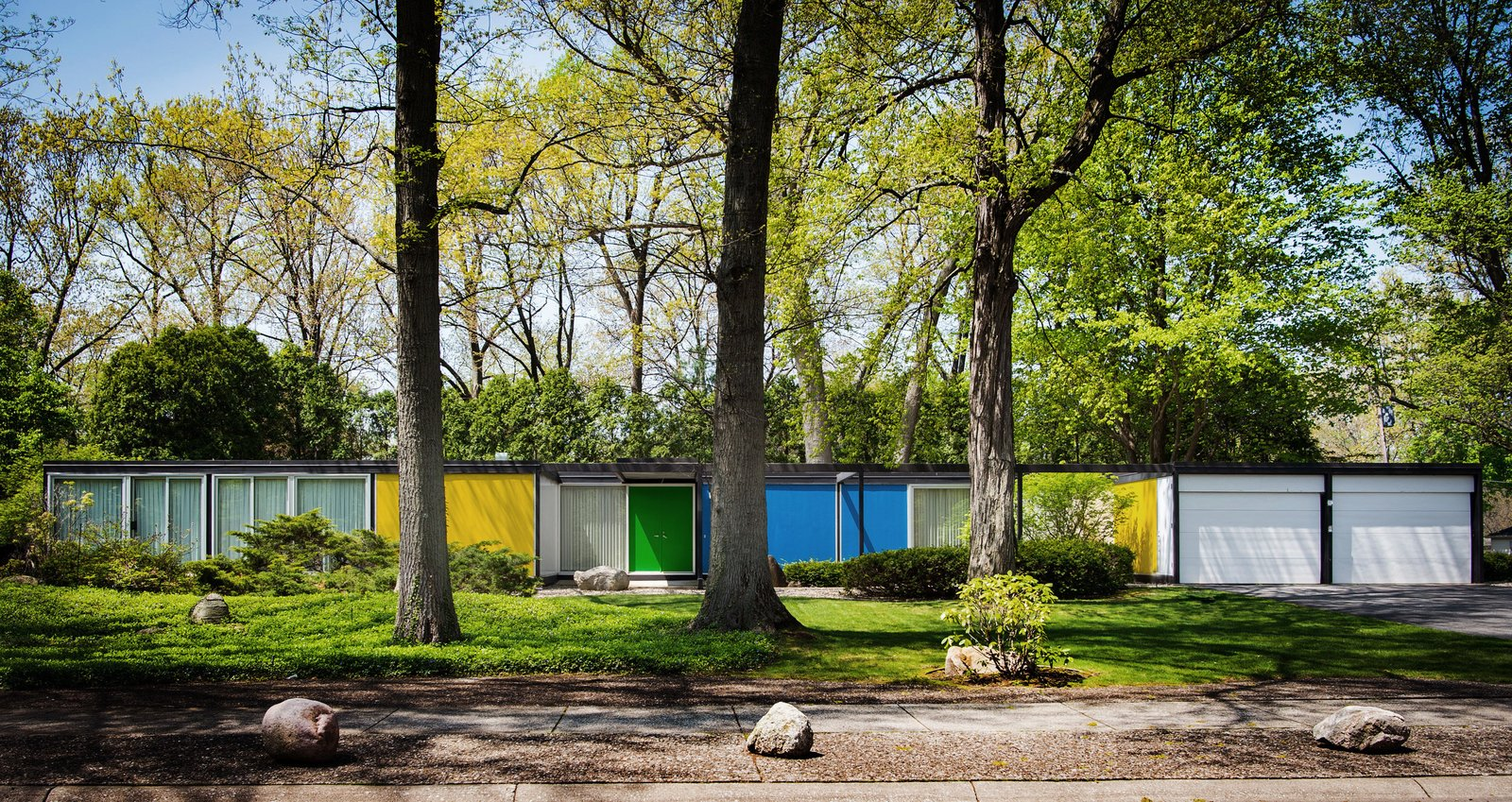 Exterior, House Building Type, Flat RoofLine, and Prefab Building Type Built with a steel frame, the Frost House features panels of styrofoam between aluminum sheets for the exterior walls and styrofoam between plywood for the roof and floors. Bold, primary colors accentuate its geometric form.   Shortly after Karen Valentine and Bob Coscarelli purchased the home in 2016, they began to unearth nuggets of information about its pedigree. Their realtor had provided a brochure that identified the prefab as designed by architect Emil Tessin for the now-defunct Alside Homes Corporation based out of Akron, Ohio, which had held a patent for the structure's aluminum paneling. Their new neighbors provided a stack of Alside Homes sales materials, floor plans of various models, and even a script that had been written for salespeople during home tours. They determined that the Frost House had been a sales model for the company, and that Tessin had been the son of Emil Albert Tessin, the legal guardian of Florence Knoll.  Photo 1 of 14 in A Rare Midcentury Prefab Looks Just Like it Did in 1958—Down to the Knoll and Paul McCobb Interiors