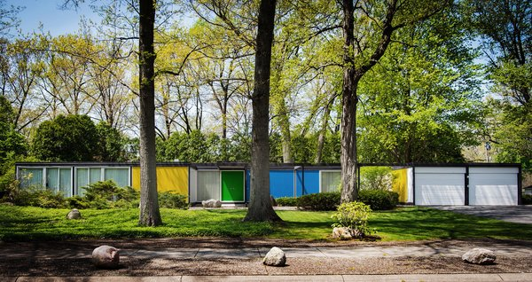 Built with a steel frame, the Frost House features panels of styrofoam between aluminum sheets for the exterior walls and styrofoam between plywood for the roof and floors. Bold, primary colors accentuate its geometric form.   Shortly after Karen Valentine and Bob Coscarelli purchased the home in 2016, they began to unearth nuggets of information about its pedigree. Their realtor had provided a brochure that identified the prefab as designed by architect Emil Tessin for the now-defunct Alside Homes Corporation based out of Akron, Ohio, which had held a patent for the structure's aluminum paneling. Their new neighbors provided a stack of Alside Homes sales materials, floor plans of various models, and even a script that had been written for salespeople during home tours. They determined that the Frost House had been a sales model for the company, and that Tessin had been the son of Emil Albert Tessin, the legal guardian of Florence Knoll.