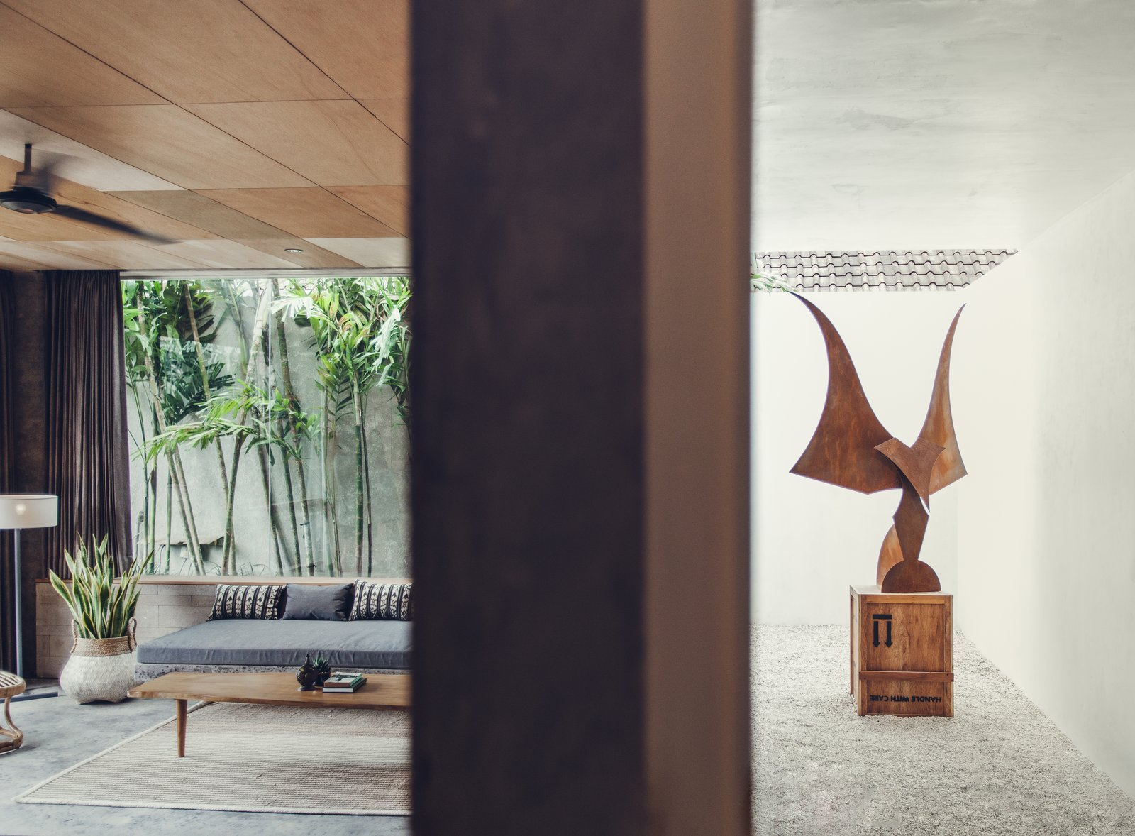 Living Room, Floor Lighting, Bench, Coffee Tables, Concrete Floor, Rug Floor, Lamps, and Recessed Lighting Garuda of Death Metal by Madsaki is a featured piece.  The Slow from Go Beyond the Basics in an Australian Fashion Designer's Surf-Inspired Bali Hotel