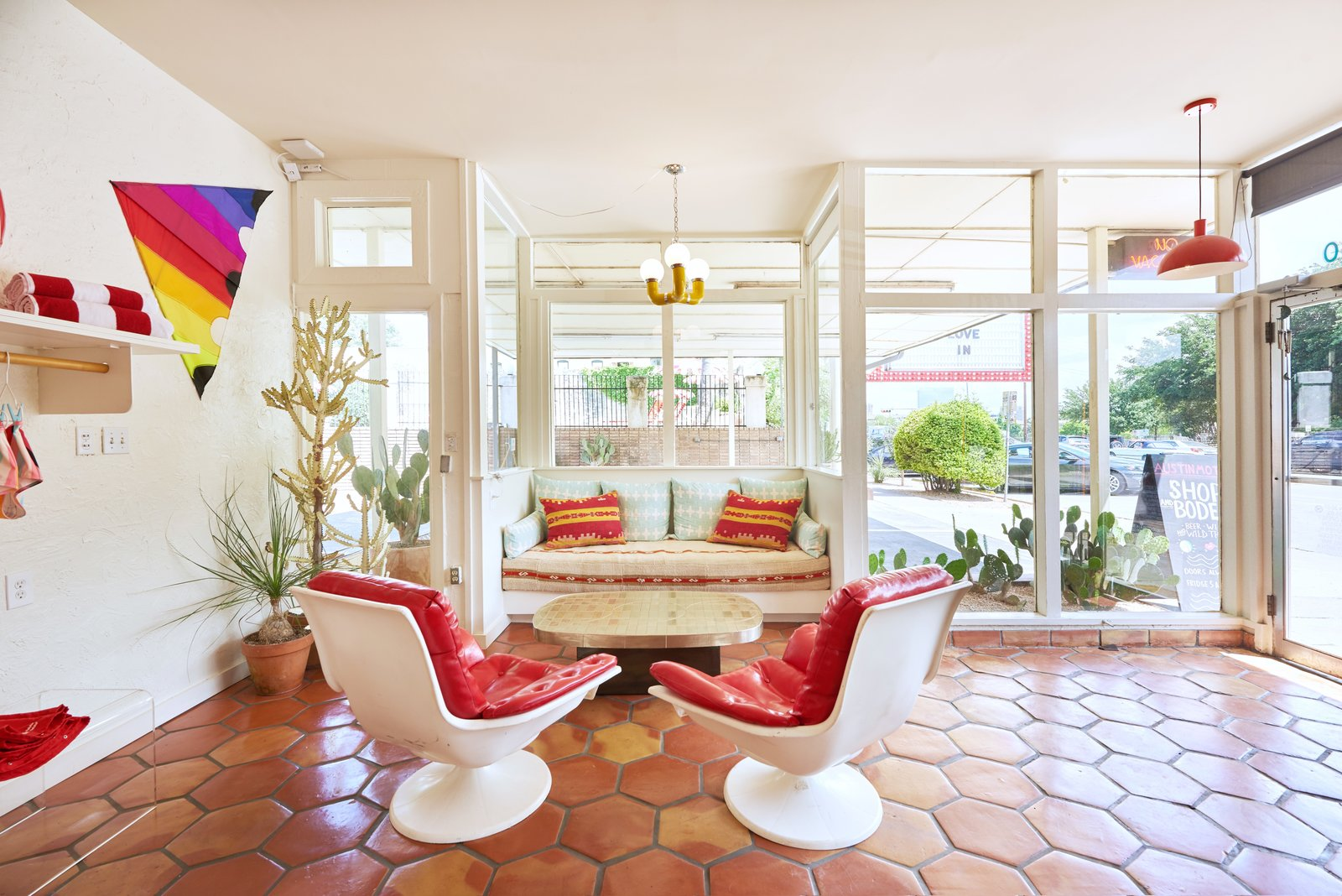 living area with terra-cotta tile flooring and built in bench seating