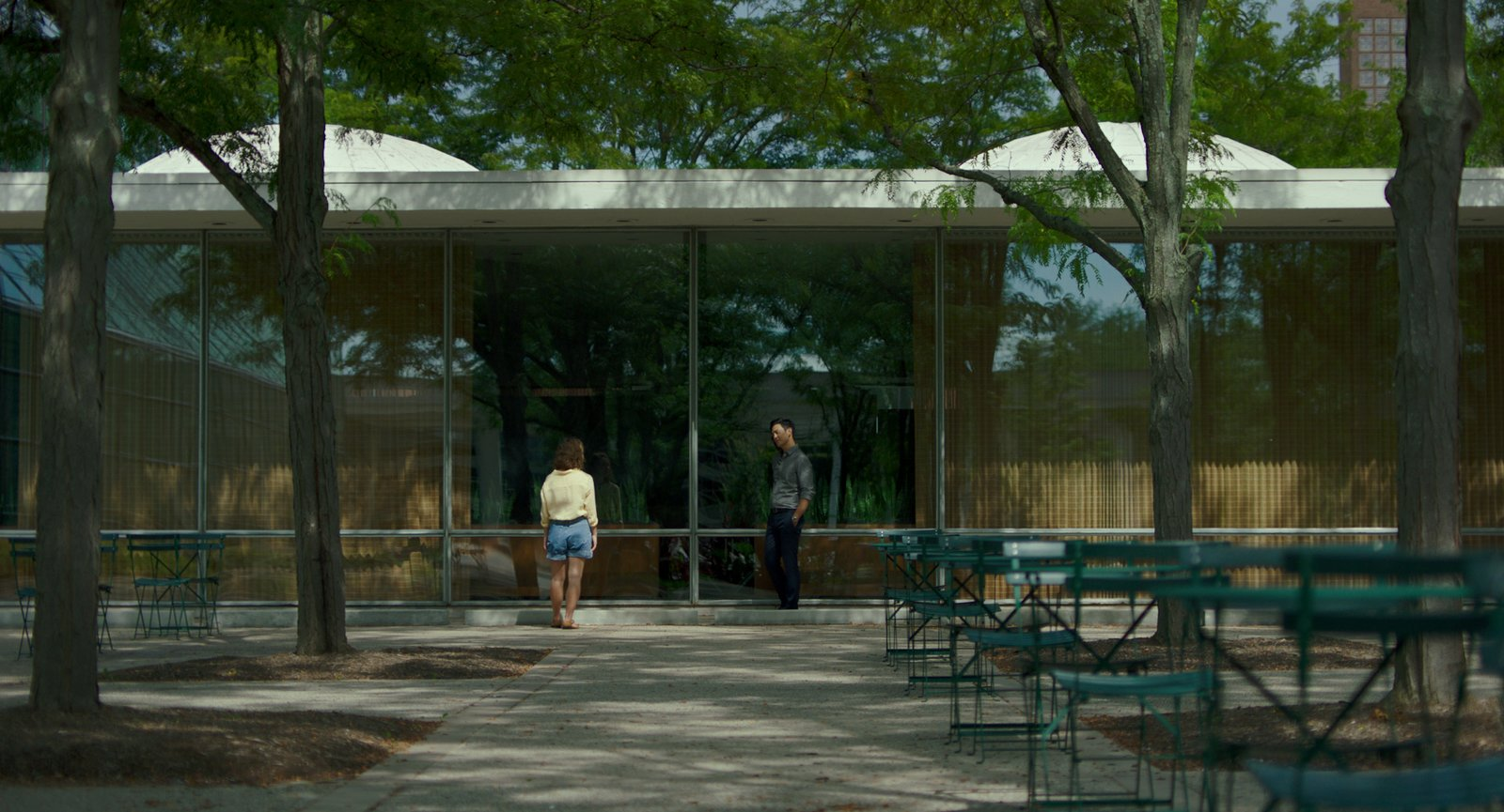 "Casey introduces Jin (John Cho) to one of her favorite buildings, Eero Saarinen's Irwin Conference Center.  Photo 4 of 8 in In the Indie Debut ""Columbus,"" Midcentury Architecture Stars Beside John Cho"
