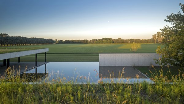 In central Argentina, the province of La Pampa is dominated by vast, grassy plains whose fertile soil supports myriad farms and ranches. Stretching out in all directions, the flatlands resemble an ocean in its sheer horizontality. When professional polo player Nacho Figueras—a champion of the sport and a longtime Ralph Lauren model—enlisted architect Juan Ignacio Ramos of Estudio Ramos to build a stable for 44 polo horses, the architect was sure to incorporate the region's meditative flatness into the design.