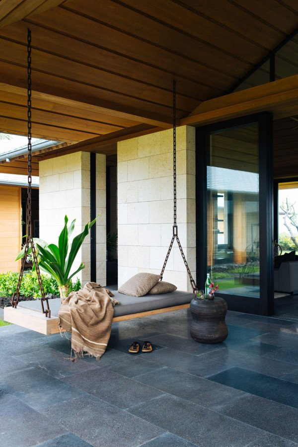 Nicole Hollis designed this contemporary home in Hawaii for a couple who were Southern California natives that fell for the coast of Kona long ago. The home boasts indoor/outdoor living that's complete with a relaxing bench swing to enjoy the Hawaiian breeze.  Photo courtesy of Laure Joliet  Simple outdoor/indoor design from 10 MODERN OUTDOOR SPACES WITH SWINGS FOR RELAXING