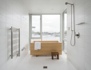 Overlooking Portage Bay in Seattle, this house was designed by Heliotrope Architects for a bachelor who longed for a simple bathroom with a Japanese-style hinoki tub that was installed in front of the windows for the water views.  Photo by Aaron Leitz