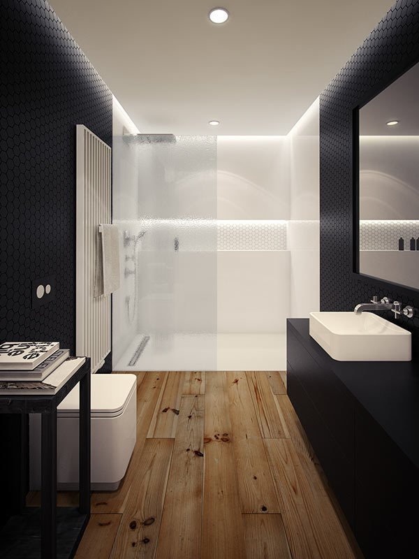 Architect and interior designer Oskar Firek created this black and white bathroom in a loft apartment in Krakow, Poland. Rustic wooden floors ground the black tile walls and cabinet, which contrast with the white shower and fixtures that round out the space.  Photo by Oskar Firek  Bathroom insperation from 10 Minimalist Bathrooms of Our Dreams