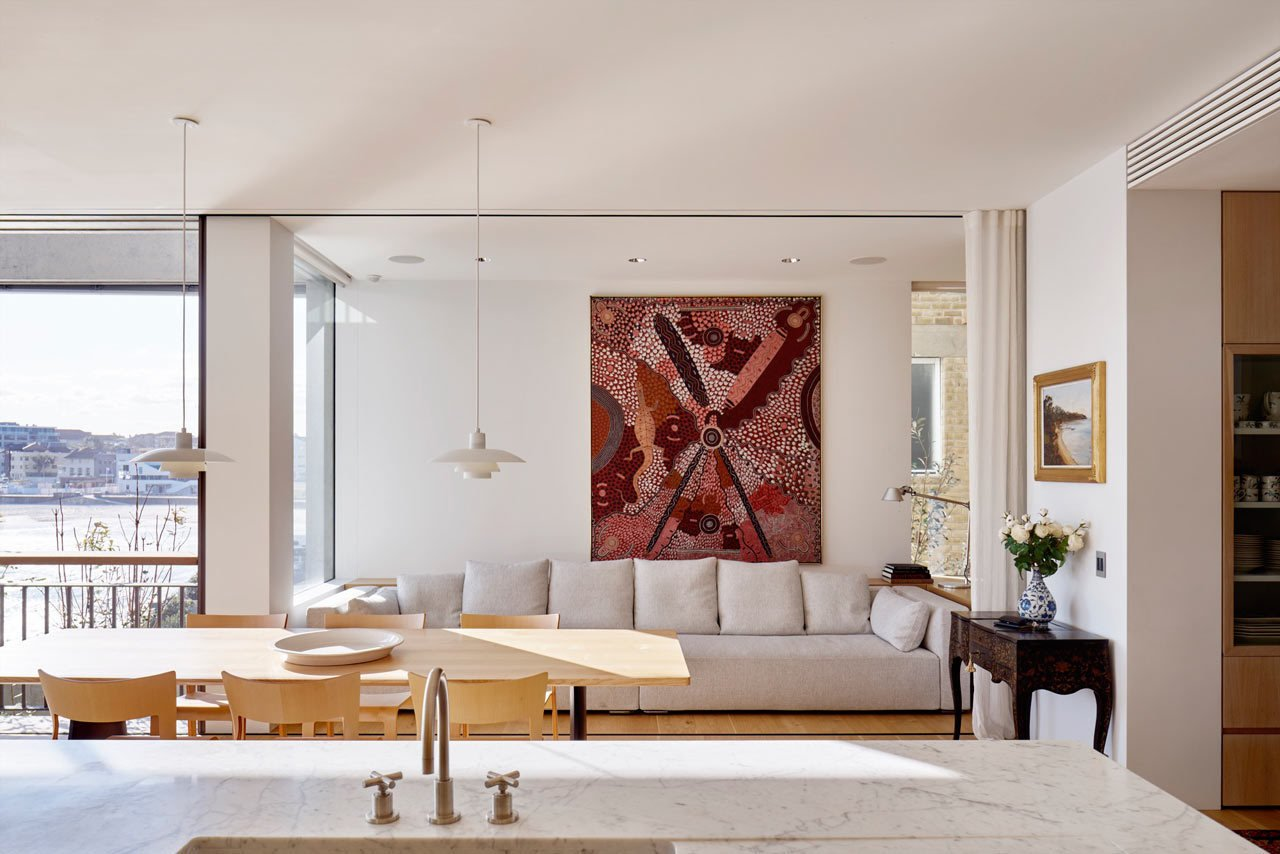 Throughout the house, paintings, sculptures, furniture, and heirlooms are thoughtfully displayed showing the family's history and travel memories. #designmilk #bondibeach #tobiaspartners  A Dream-Worthy Beach House at Bondi Beach