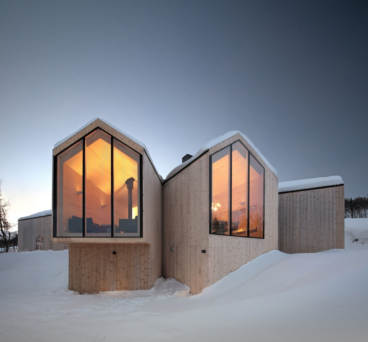 Exterior, House Building Type, Metal Roof Material, Wood Siding Material, and Gable RoofLine Designed by Reiulf Ramstad Arkitekter for a family of four, the Split View Mountain Lodge is a holiday home near the village of Geilo, Norway. The main volume splits out to form additional annexes that frame individual views of the surrounding mountains.