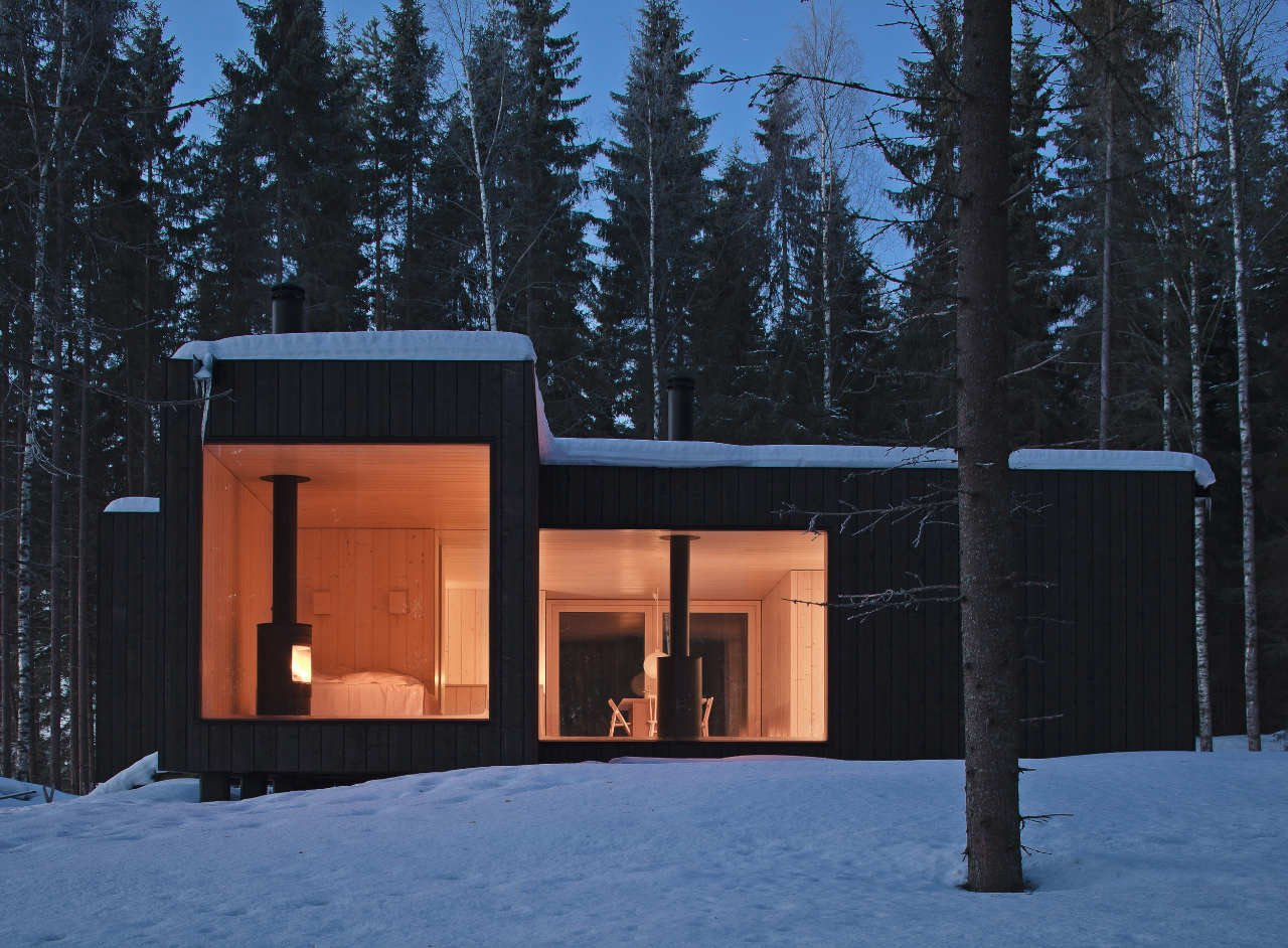 Exterior, Metal Roof Material, Cabin Building Type, House Building Type, Flat RoofLine, and Wood Siding Material Shaped like a cross, this four-cornered villa offers four different views of its location on an island in Finland. Avanto Architects created a black exterior, dotted with large windows, to make it invisible from the nearby lake.