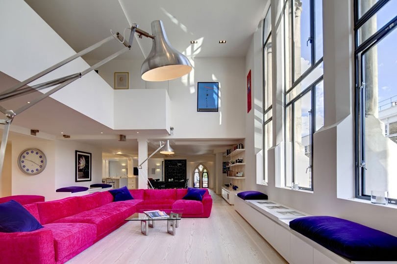 Dating back to 1853, London's Westbourne Grove Church was renovated by DOS Architects, who took on the top two floors turning them into a light-filled, open plan loft. The walls and floors might be white, but the furniture and furnishings are anything but.  Photo 4 of 10 in Traditional Churches Become Modern Homes