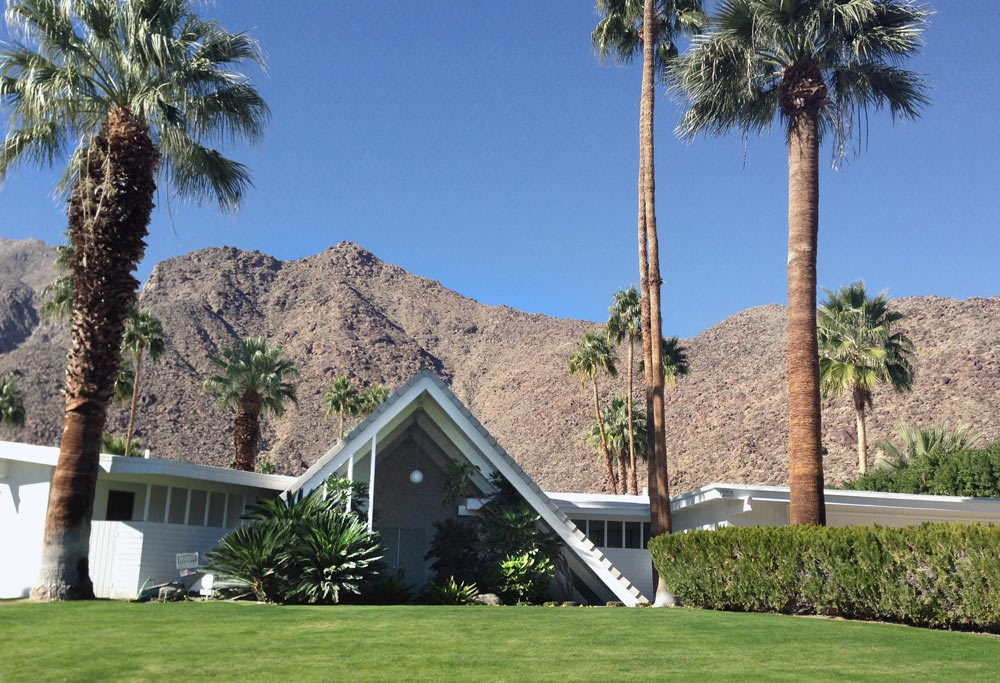 With a triangular A-frame front, similar to that of a Swiss ski chalet, the Swiss Miss houses were designed by Charles Dubois in a section with about 15 other homes just like it. The unusual front spans two-stories tall giving the home some dramatic curb appeal.  Ideal Angles by Jill Southern from 8 Iconic Houses in Palm Springs, California