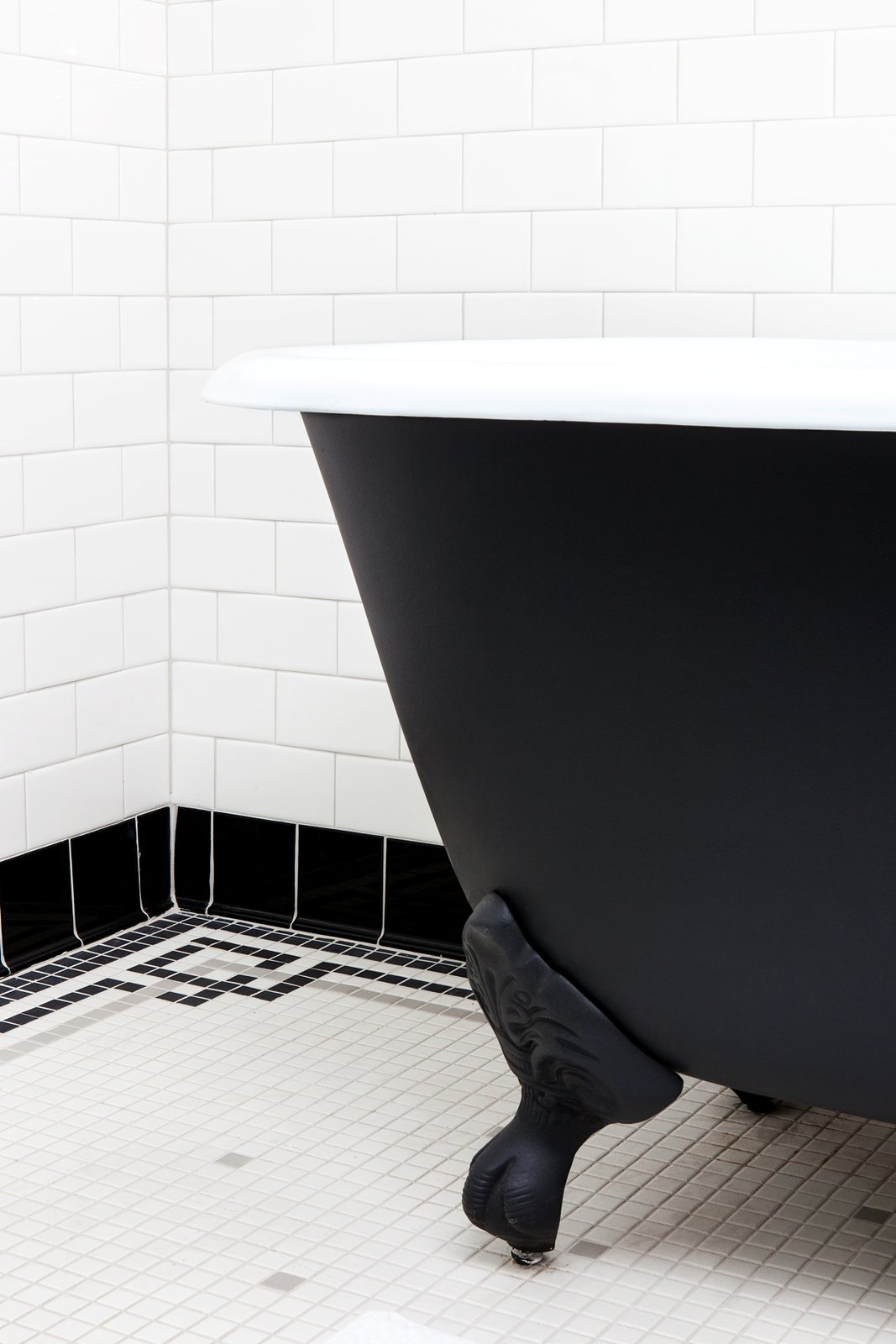 Bath Room, Subway Tile Wall, Freestanding Tub, and Ceramic Tile Floor Brass fixtures and soaking claw foot tubs in the bathrooms give a classic feel to the modern hotel experience.  Photo 9 of 18 in Lokal: A Classic Hotel with a Modern Invisible Service