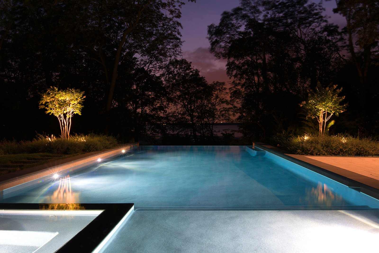 The pool, lighting, and landscape frame dramatic views of sunsets over the Long Island Sound.  Free Float Pool Cabana by The UP Studio