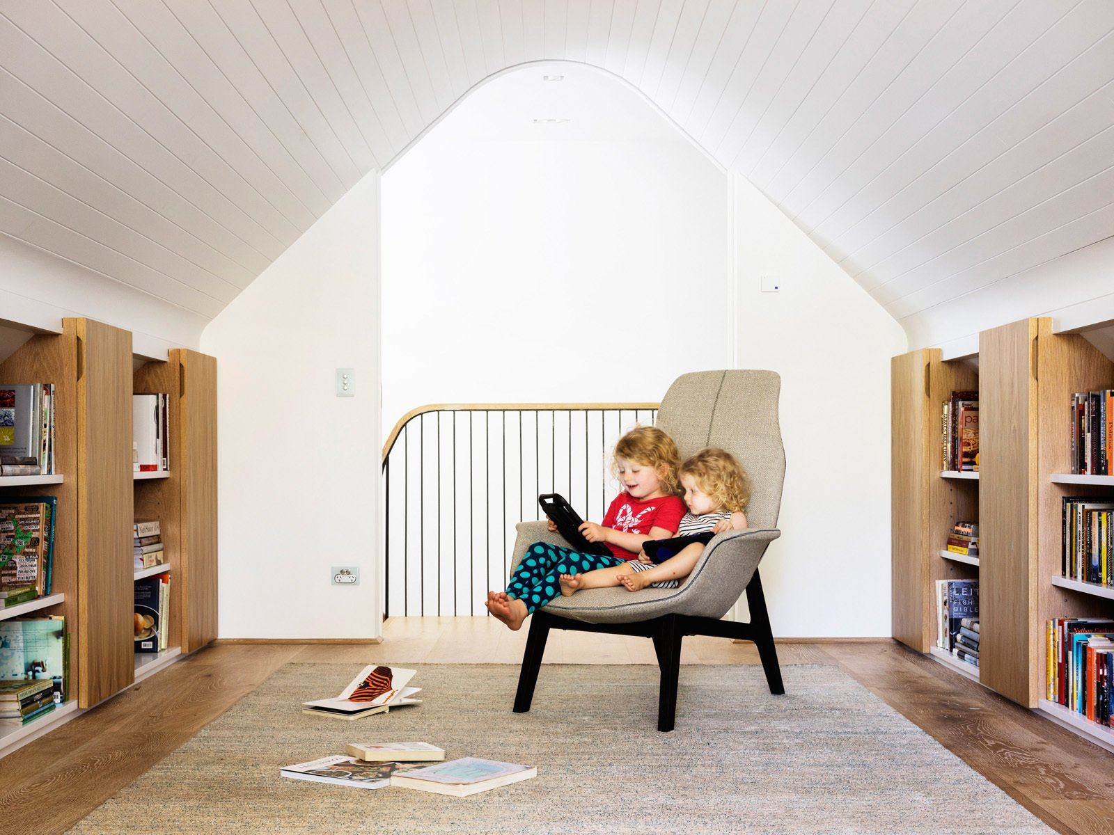 Initially, the attic room was going to be a study for the hard working parents but the girls appropriated it as their wet weather playroom. © Justin Alexander  Loggia in Arcadia by Luigi Rosselli Architects