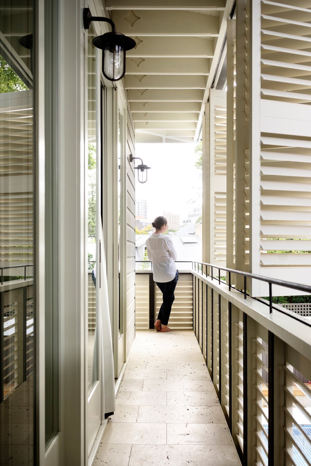 The loggia, or first floor covered balcony, is also a privacy screen that allows filtered air and light and obscures the neighbours' view. The shutters were masterfully constructed by the builder and Shutters Australia. Shutters Australia © Justin Alexander  Loggia in Arcadia by Luigi Rosselli Architects