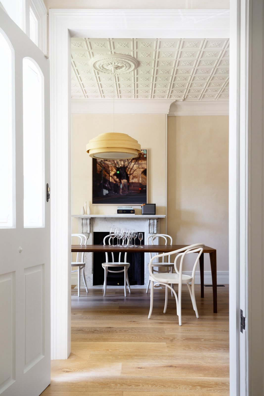 In the dining room the Carrara fire surround, waxed stucco lucido plaster walls and Thonet chairs all have one thing in common, they are all classics, classic materials, classic designs. © Justin Alexander  Loggia in Arcadia by Luigi Rosselli Architects
