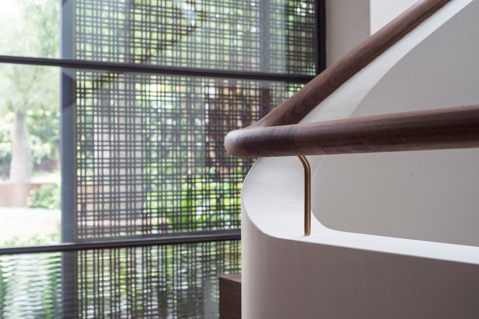 A timber handrail and masonry parapet follow the stair effortlessly, as if they had been formed with modelling clay. © Edward Birch  Harbour Front-Row Seat by Luigi Rosselli Architects