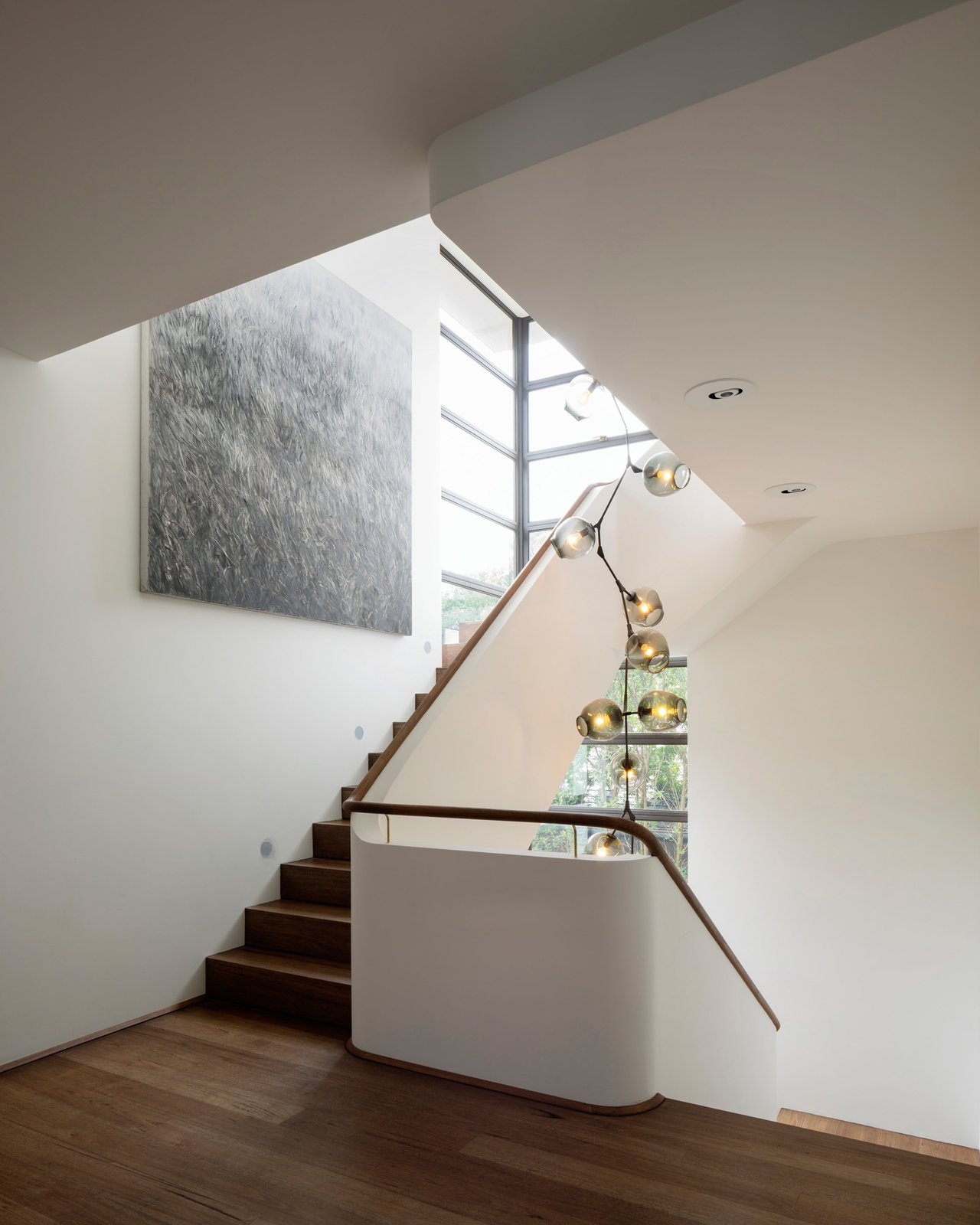 The seven metre tall Lindsey Adelman chandelier dominates the stairwell. Light projectors, concealed in the suspended ceiling, illuminate the artwork. www.lindseyadelman.com © Justin Alexander  Harbour Front-Row Seat by Luigi Rosselli Architects
