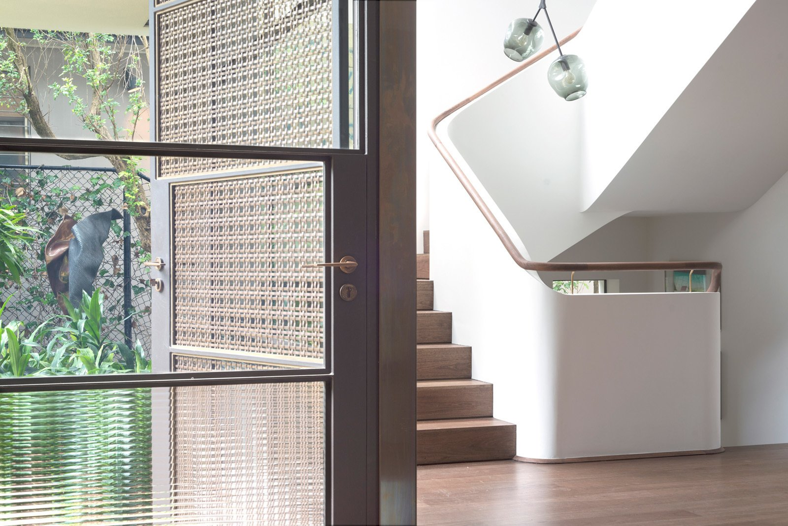 The entrance hall is bathed in light from the stairwell both day and night. © Edward Birch  Harbour Front-Row Seat by Luigi Rosselli Architects