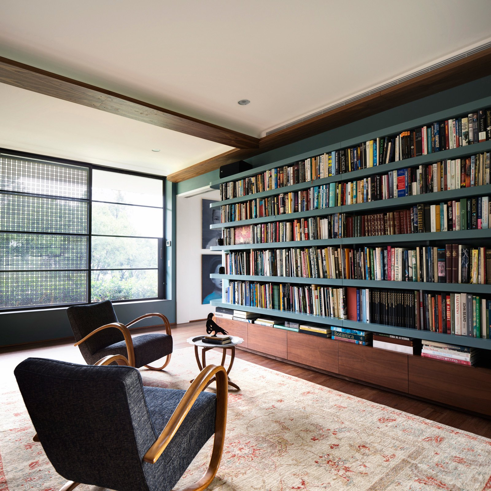 1930s Halabala [ www.designaddict.com/atlas/designers/Jindrich-Halabala/ ] reading chairs contemplate the densely packed library. © Justin Alexander  Harbour Front-Row Seat by Luigi Rosselli Architects