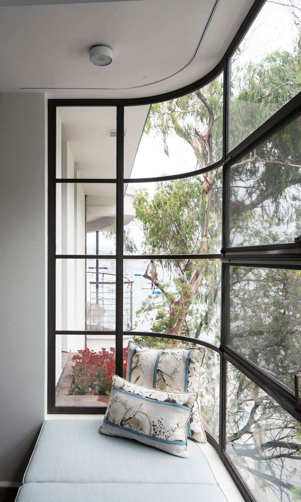 Bay windows have expanded the existing house sideways, providing side viewing lines to Double Bay and Sydney Harbour © Edward Birch  Harbour Front-Row Seat by Luigi Rosselli Architects