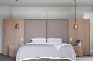 Copper-hued pendants stun in this bedroom, bringing a metallic sheen to natural and matte finishes. When it comes to bedroom lighting ideas for the ceiling, we can't get enough of this look for both style and functionality.