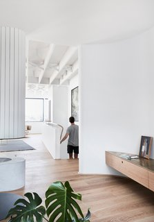 The crisp white walls contrast beautifully with the warm, timber floors, which are Sepia Grande Eterno engineered boards by Tongue N Groove.
