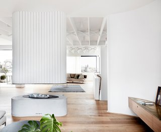 The crisp white walls contrast beautifully with the warm wooden floors throughout.