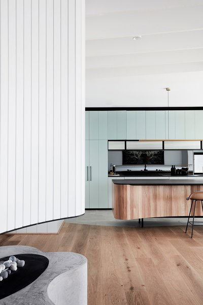 A peek at the contemporary kitchen. Here, the joinery was built by Building With Options and the laboratory grade was provided by Stone Italiana.