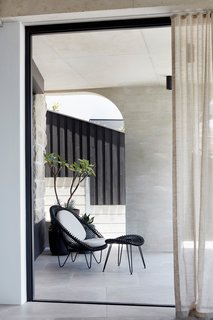 """Another covered terrace. This roof and pillar is reflected in a cement-colored vitrified ceramic tile named """"Memory Mood,"""" which has been supplied by Terra Nova Ceramics."""