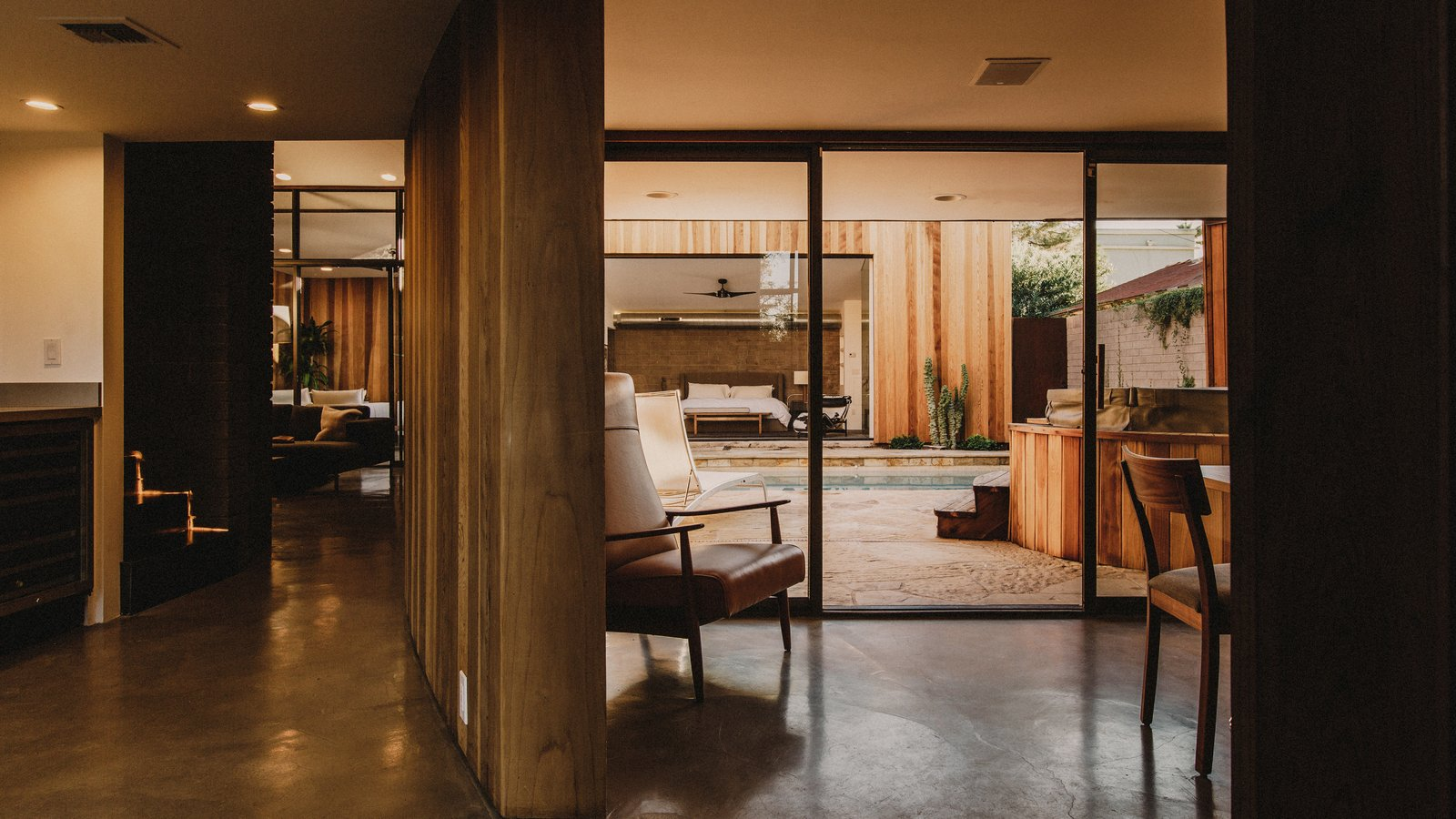 The entry to the house allow multiple sight lines through the house to the various courtyards and patios  Curves House by The Ranch Mine
