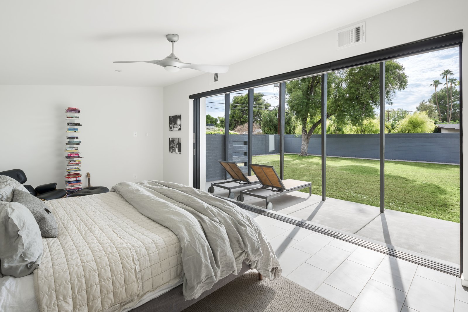Bedroom, Bed, Ceiling, and Porcelain Tile Master bedroom opened up to the patio and yard beyond  Best Bedroom Bed Porcelain Tile Photos from Schreiber House