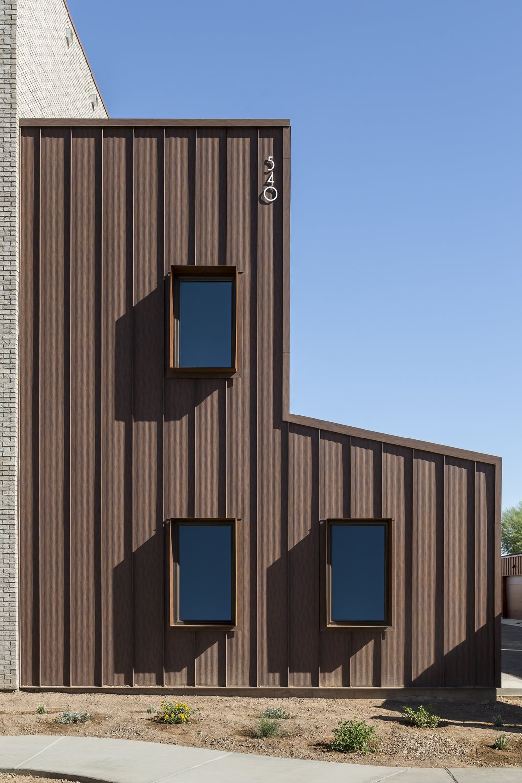 Windows, Metal, and Casement Window Type Custom Cor-Ten steel window boxes add shade to south facing windows  Uptown Row