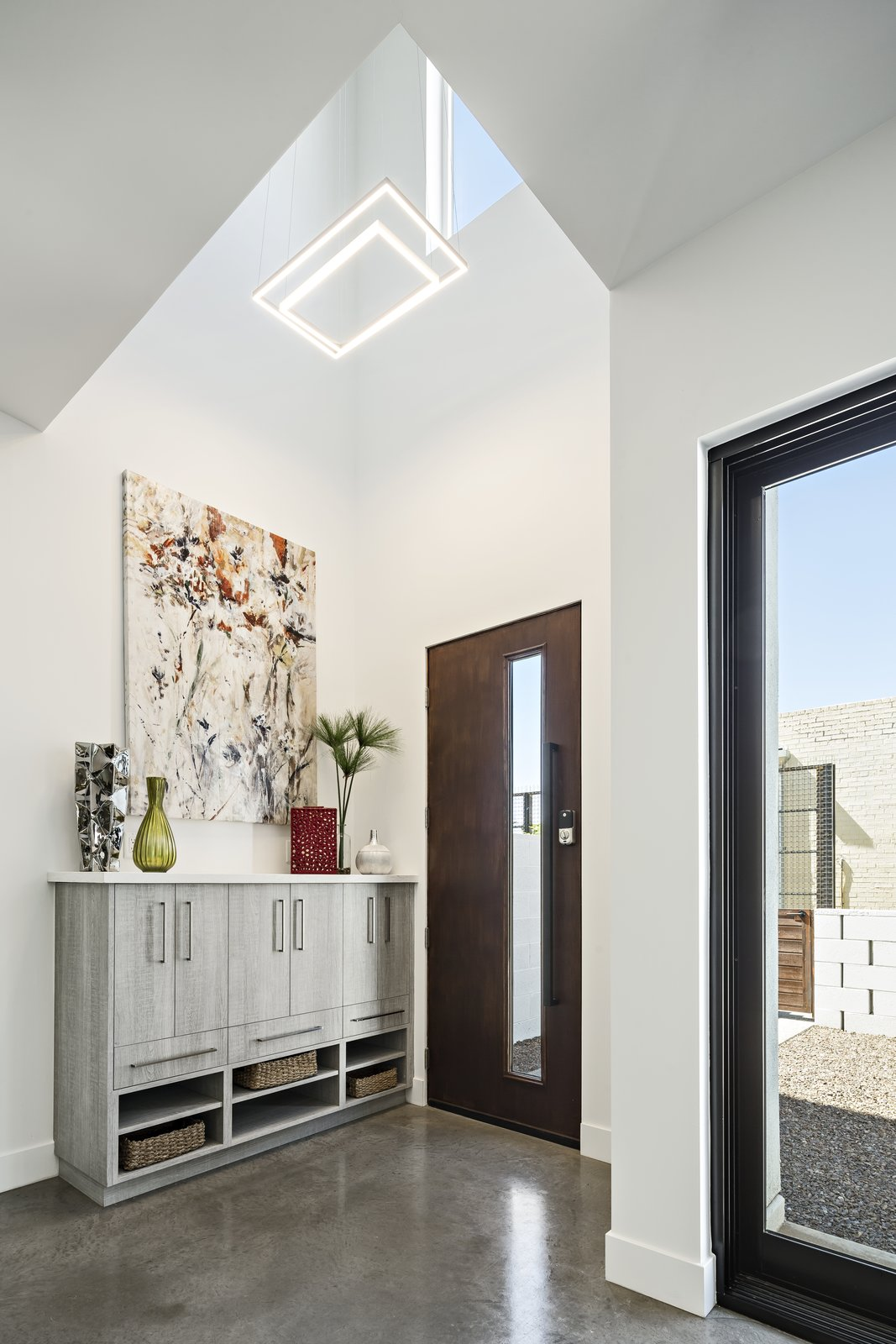 Hallway and Concrete Floor Double height entry  Uptown Row