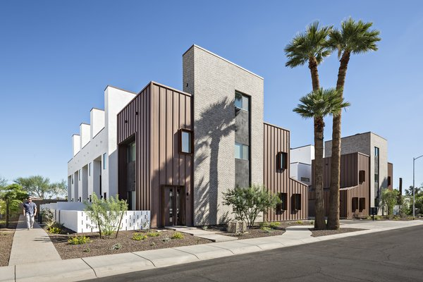 Uptown Row sits less than 1000 feet away from a light rail station in uptown Phoenix. This greyfield development adds 10, 3 story single-family attached homes, each with their own private courtyard and roof deck