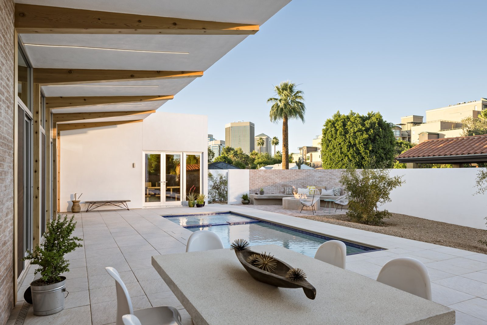 Outdoor, Side Yard, Small, Trees, Hardscapes, Pavers, Decomposed Granite, and Desert A 10 foot deep cantilevered roof provides consistent shade pool side in the courtyard  Best Outdoor Desert Decomposed Granite Photos from Sol House