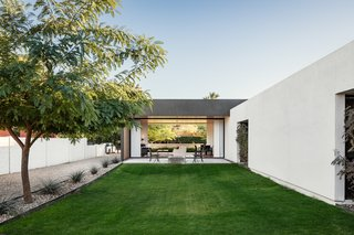 The yard doubles as the retention area for the monsoon rainstorms as well as a place for the homeowners to play