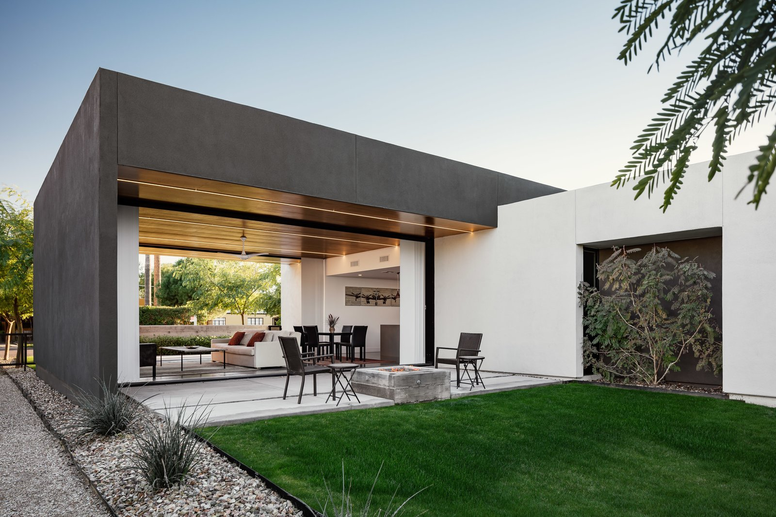 Concrete, Front Yard, Trees, Ceiling, Concrete, Back Yard, Grass, Exterior, and Stucco A board formed concrete fire pit draws you out to the back patio from the open living space  Exterior Concrete Grass Photos from Link House
