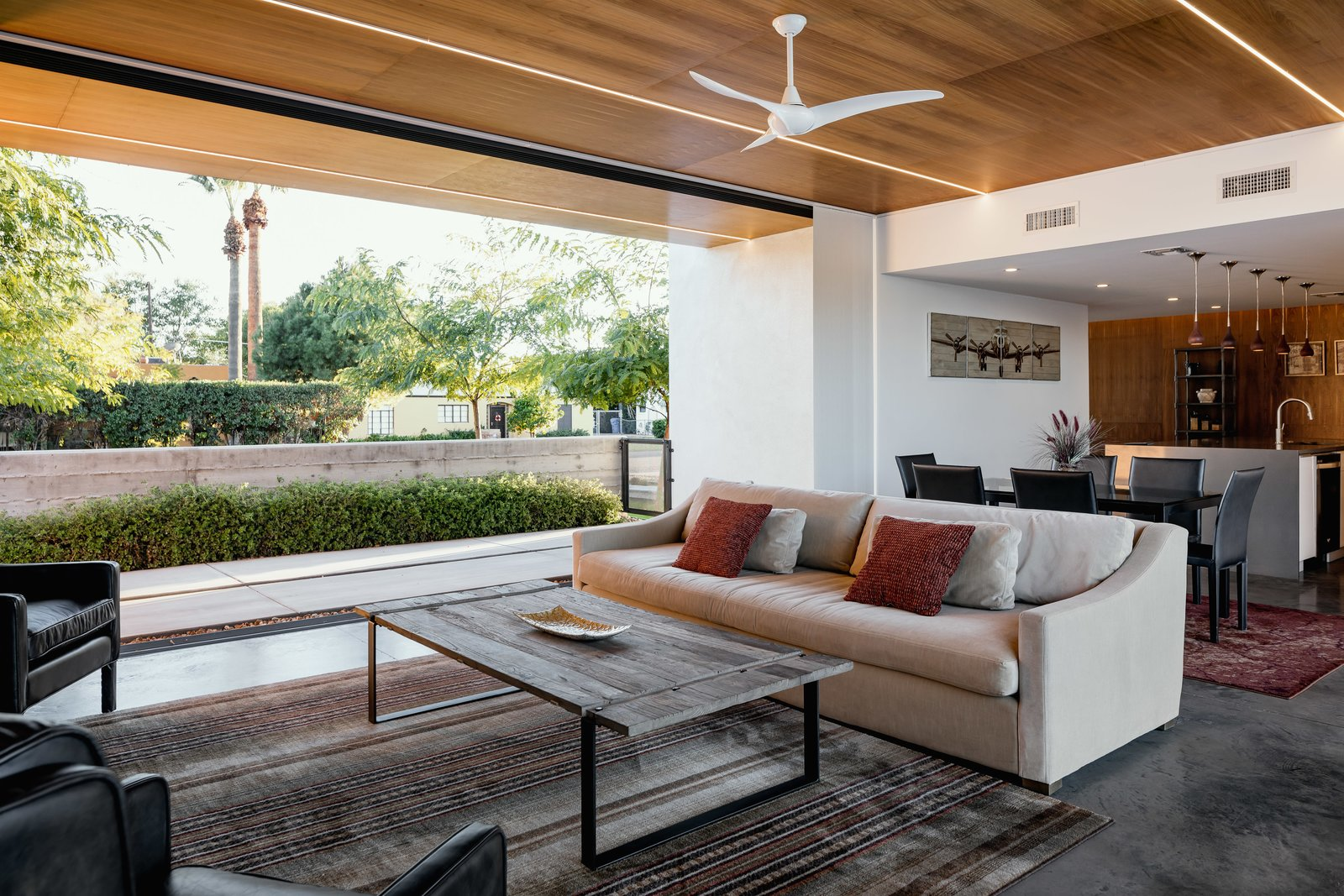 Concrete, Shrubs, Trees, Living, Front Yard, Sofa, Coffee Tables, Ceiling, and Concrete The walnut clad ceiling extends over the kitchen to the entry  Best Living Concrete Photos