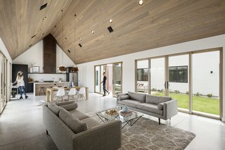 Great room with vaulted ceiling and flooded with natural light from the north and south