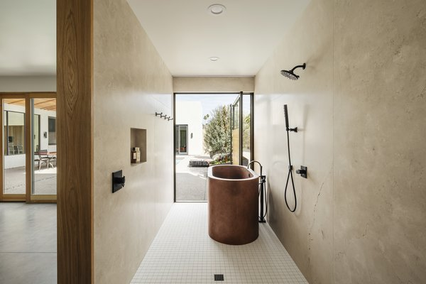 Once the pivot door is opened, the indoor bathing and showering experience becomes an outdoor experience