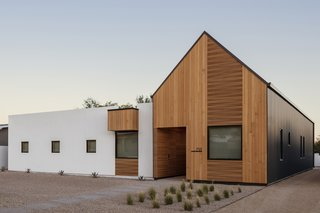 "The house draws its name, ""Pleats,"" from the corrugated metal that wraps the gabled volume, reminiscent of the pleated exterior of the Saguaro cactus."