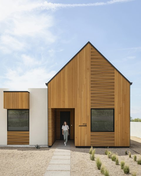 The gabled entry features a patterned, wood rainscreen that evokes the forked ribs of the Saguaro cactus while the recessed entry is akin to a Saguaro boot, the holes in the giant cacti that many desert animals use as their homes.