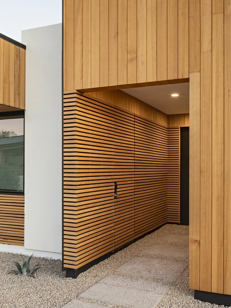 The recessed entry features a disguised door for guests