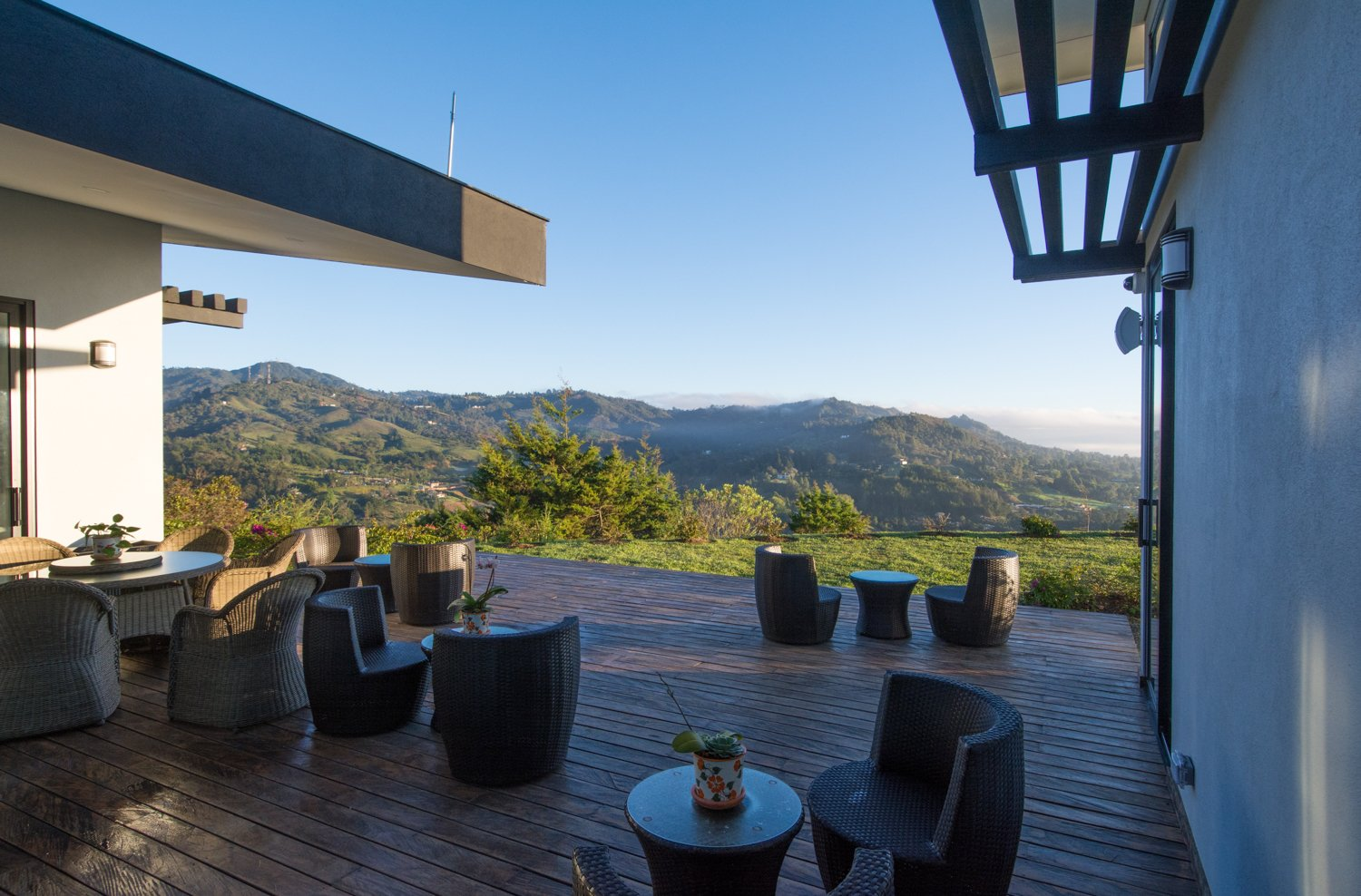 Deck with outdoor kitchen and fabulous views  House in Medellin by evoDOMUS LLC
