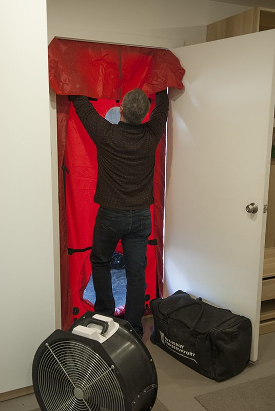 Our HERS specialist Rob is installing the fan for a blower door test  Gallery
