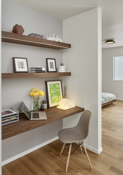 The office nook features a custom desk and shelf by Matt Eastvold